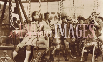 media-image-006-juveniles-riding-a-hand-cranked-dobbie-set-at-redruth-cornwall-in-1922-rp