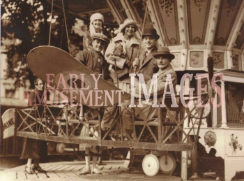 media-image-039-first-flight-family-portrait-amusement-flying-machine-c-1920-rp